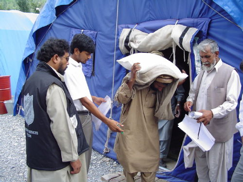 Final distribution from an Oxfam tent
