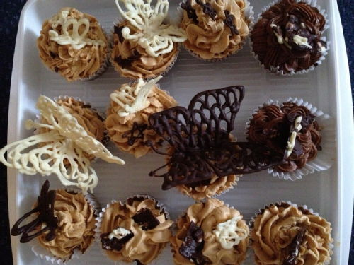Cupcakes decorated with salted caramel buttercream and chocolate butterflies