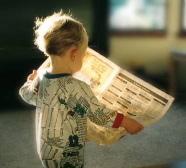 child_reading_newspaper.jpg
