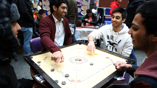 Game of Carrom Karrom at University of Warwick Students Union during One world week 2013