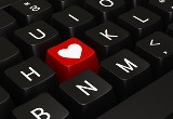 Image of a PC keyboard with one key replaced with a heart