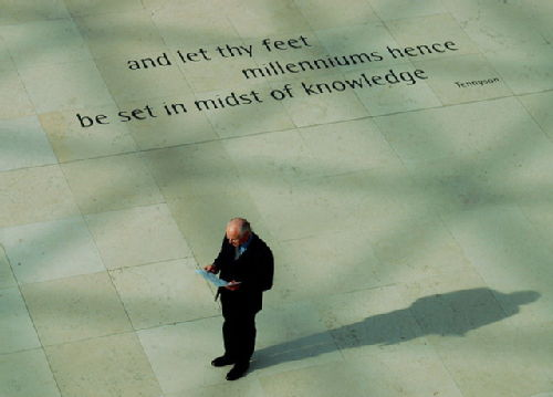 Photograph: A moment captured in the British Museum: man stands next to a Tennyson quote engraved in the floor