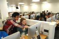 Photograph of students using the Orchard computer suite at the University of Warwick. The suite got its nickname as its filled with Apple computers.