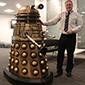 Image. Simon Bradley, EADS, standing next to a Dalek