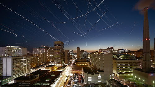 Image. Stars and planes across the Toronto skyline