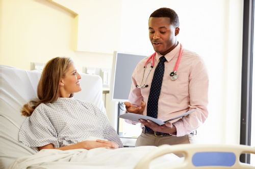 student talking to patient