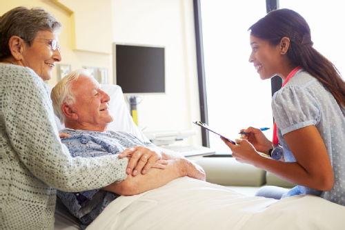 elderly couple talking to doctor