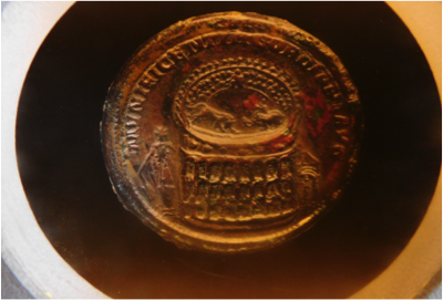 coin showing colosseum