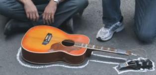 United Airlines breaks guitar.