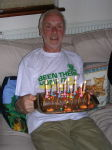 Dad recovering post-marathon with birthday cake