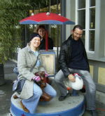 Outside the tourist information centre - Graeme seems to be having trouble staying astride his duck!