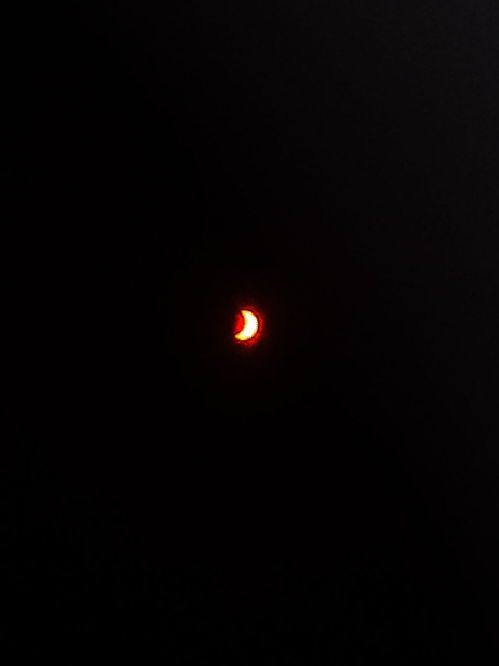 Solar eclipse with an iPhone through protective glasses