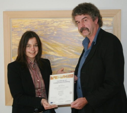 Chris Salt of ABC Desks receives their certificate from Nicki of Penstamps.com